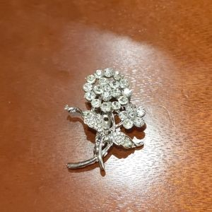 Silver  and rhinestone floral broach